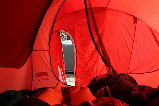 camping in a red tent