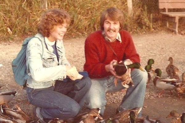 parents feeding ducks